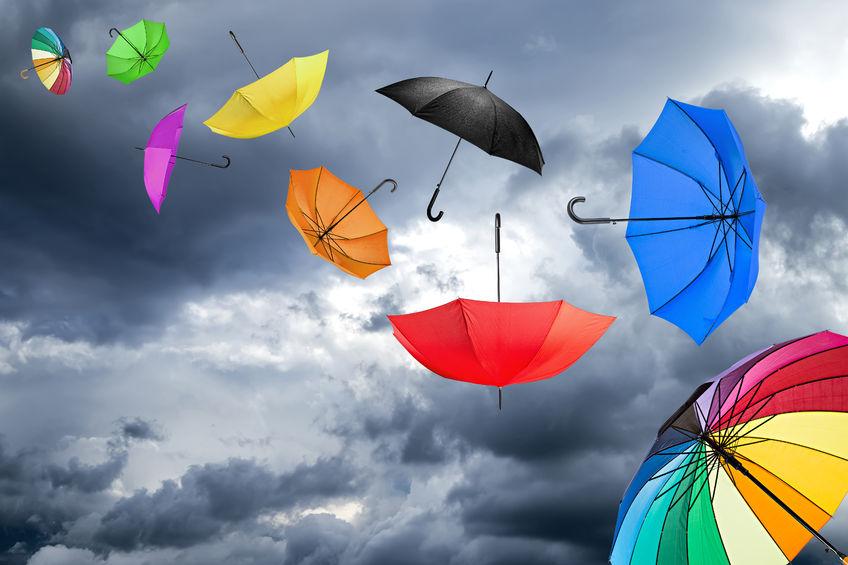 34013738 - flying umbrellas in front of dark sky