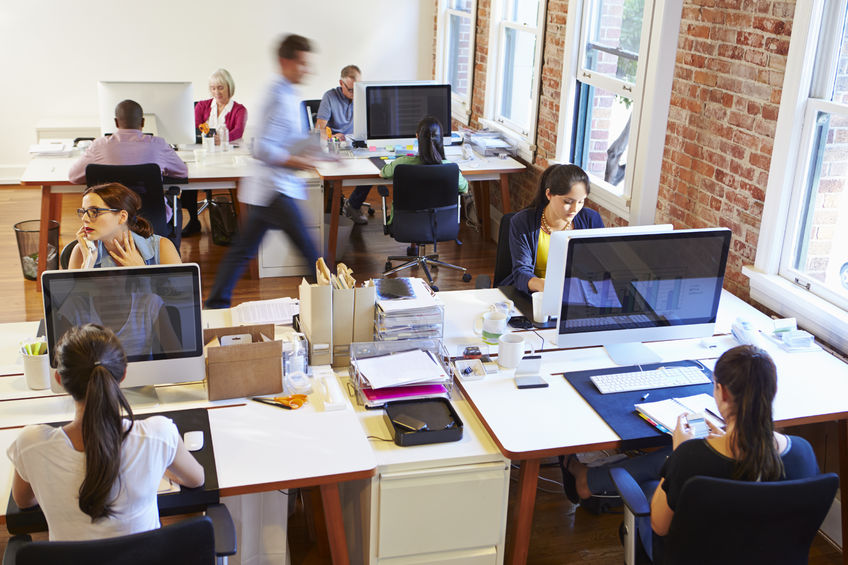 42307663 - wide angle view of busy design office with workers at desks