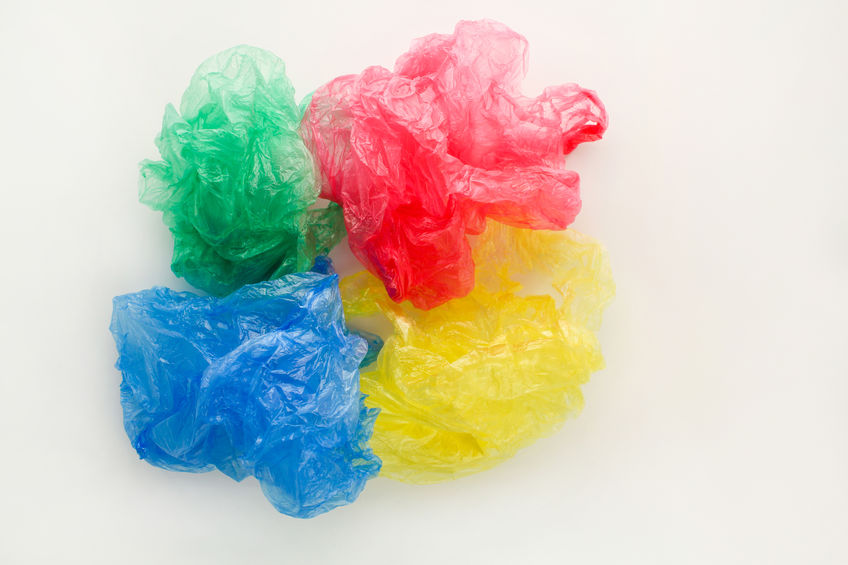 74423154 - different plastic bags on white background. top view.