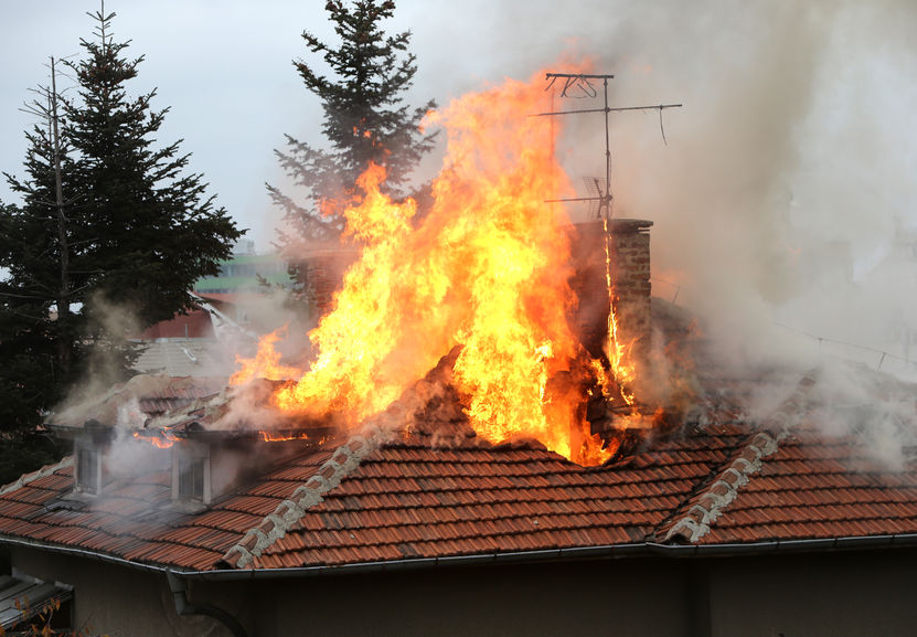 36489593 - a house roof on fire and smoke.