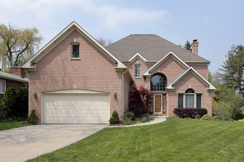 33458574 - suburban brick home with arched window above entry