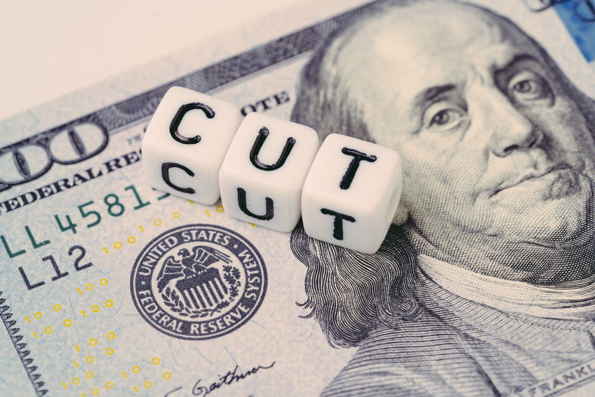 FED, Federal Reserve with interest rate cut concept, small cube